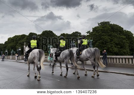 OSLO, NORWAY - JULY 1, 2016: Mounted police in the Vigeland park is no less interesting than the sculpture of Vigeland.