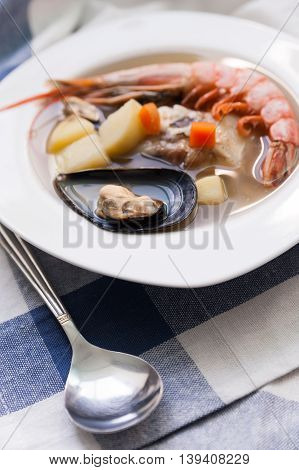 Traditional Mediterranean seafood soup with mussels, flounder and shrimp