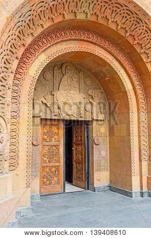 YEREVAN ARMENIA - MAY 29 2016: The entrance to the St Sarkis Cathedral decorated with the carved patterns on travertine on May 29 in Yerevan.