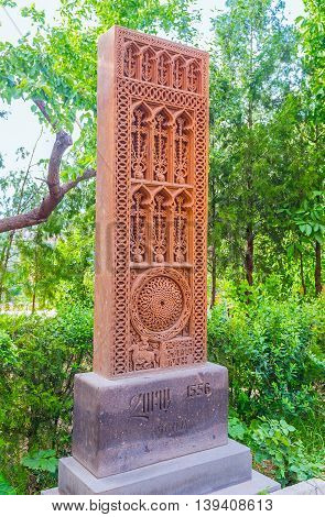 YEREVAN ARMENIA - MAY 29 2016: The replica of the medieval Khachkar located on territory of St John the Baptist Church on May 29 in Yerevan.