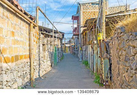 The narrow street of the old neighborhood full of slums located in Yerevan Armenia.