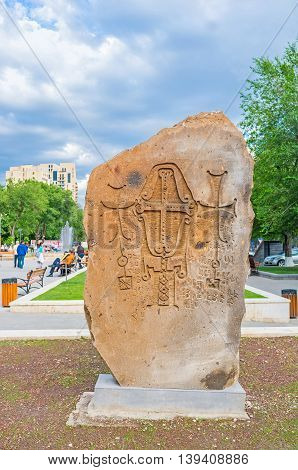 YEREVAN ARMENIA - MAY 29 2016: The Khachkar with carved crosses in the open air exhibition named The Cultural Genocide: symbol of Khachkars on May 29 in Yerevan.