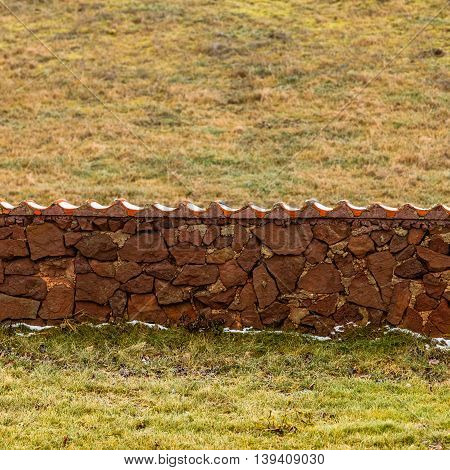 View of stone fence on field in the countryside landscape outdoor