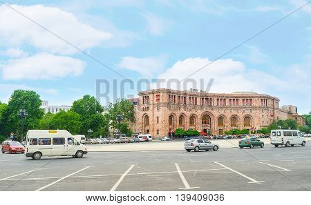 YEREVAN ARMENIA - MAY 29 2016: The wide road across the Republic Square with the building of the luxury hotel on the background on May 29 in Yerevan.