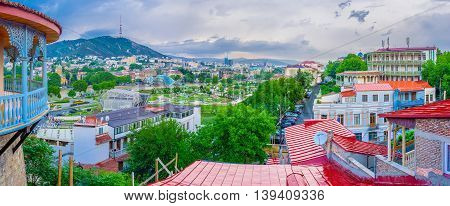 TBILISI GEORGIA - MAY 28 2016: Panoramic view of the city with Sololaki Hill Rike Park Peace bridge and the balcony of Sachino Palace on May 28 in Tbilisi.