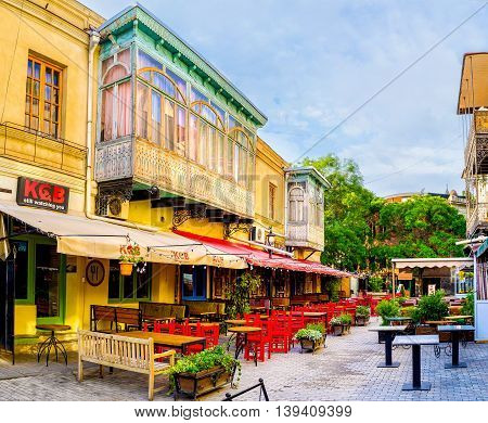 TBILISI GEORGIA - MAY 28 2016: The morning street of closed restaurants is quiet and empty on May 28 in Tbilisi.