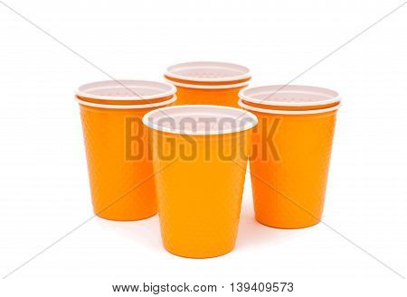 Orange plastic cups on a white background