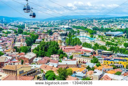 The of Sololaki Hill overlooks the center of old Tbilisi with the red roofs main churches Kura river and the famous cableway Georgia.