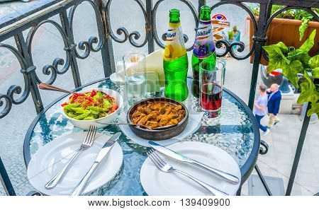 TBILISI GEORGIA - MAY 28 2016: The tasty dinner in the local restaurant on the summer terrace on May 28 in Tbilisi.