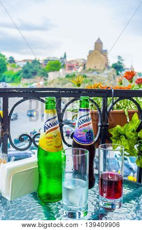 TBILISI GEORGIA - MAY 28 2016: The refreshing Georgian lemonade is the best way to relax in one of the city cafes on May 28 in Tbilisi.