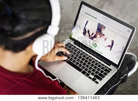 Man Playing Music Application Connection Laptop Concept