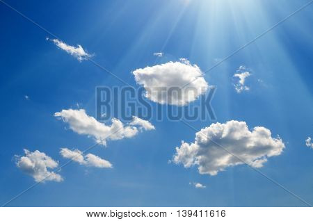 Shining sun at cloudy blue sky with copy space