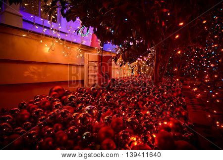 Christmas balls and lights spreaded around a New Zealand house during Festive Season