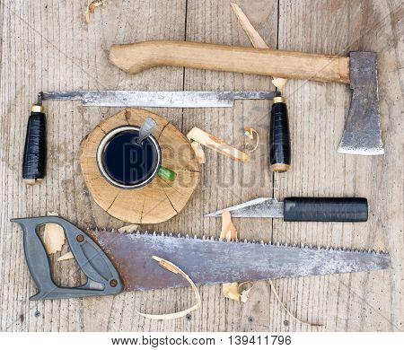 Od vintage hand tools on wooden background. Carpenter workplace
