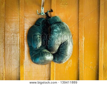 old boxing gloves on brown a wall