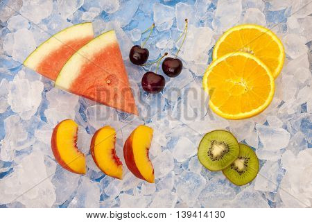Assorted fruit on ice. An assortment of fruit slices and wedges on ice.