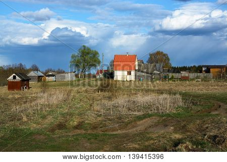 Landscape of North Russian village and road in springtime.