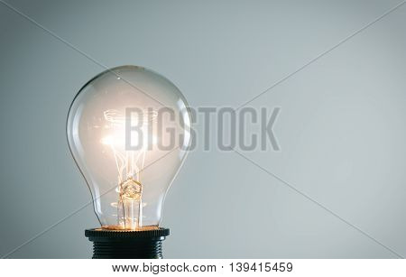 Photo of vintage glowing light bulb. Idea concept