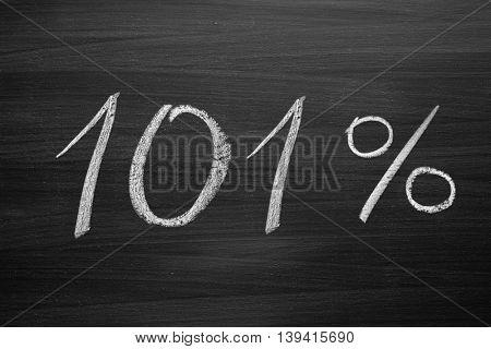 101 percent header written with a chalk on the blackboard