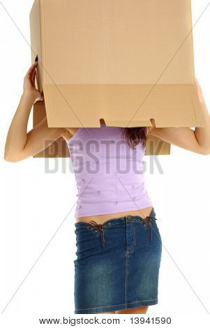 Young woman hidden behind the tall stack of boxes she is carrying. Head in box.