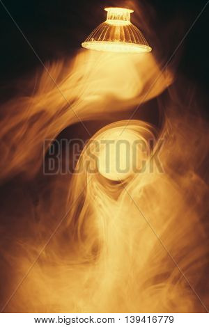 halogen lamp with warm light in smoke