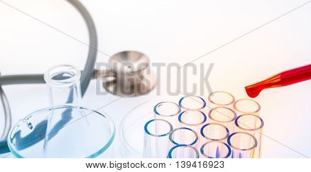 laboratory test tubes,medical glassware , Stethoscope  ( Filtered image processed colorful effect. )