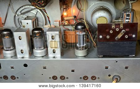 Interior of a vintage radio receiver. Outdated technology.