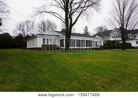 WEQUENTONSING, MICHIGAN / UNITED STATES - DECEMBER 22, 2015: A home on Beach Drive in Wequetonsing, Michigan.