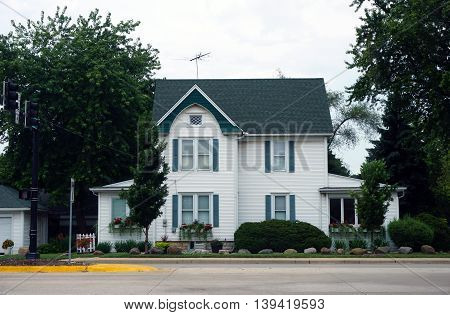 A large white home near downtown Plainfield, Illinois.