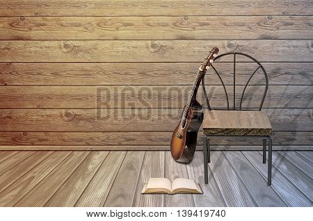 Old guitarchair and blank open book on the floor.