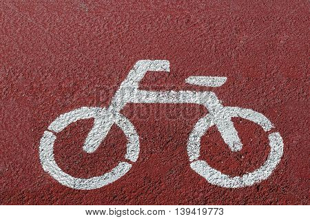 White painted sign for bikes on road.