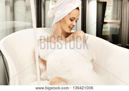 Young Beautiful Red-haired Woman Takes Bubble Bath