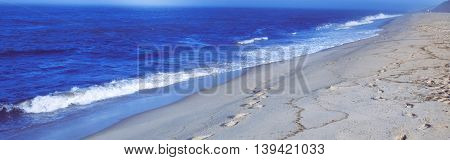 Blue water on beach and waves at Wellfleet Massachusetts on Cape Cod-Proportionate to Large Mobile Banner