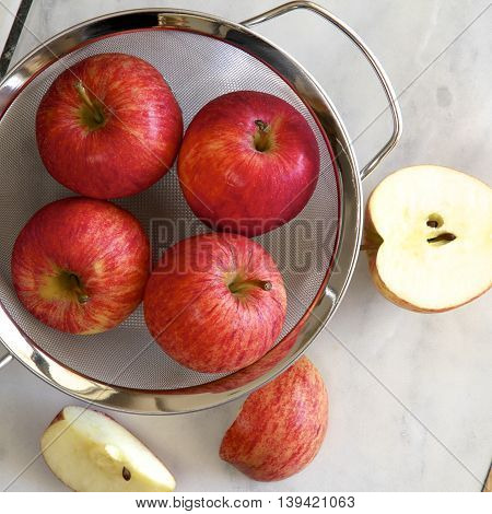 A sieve full of Royal Gala Apples
