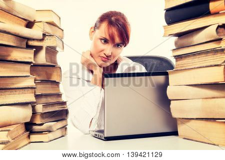 Education Concept. Beautiful Young Woman With Stack Of Books With Her Laptop On White Background