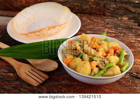 Kerala cuisine-Soft Appam served with hearty mutton stew