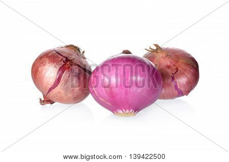 whole uncooked red onion or shallot on white background