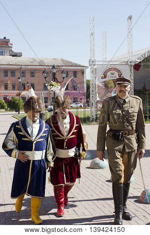 Men in vintage traditional national and military costumes of Ukraine and Poland