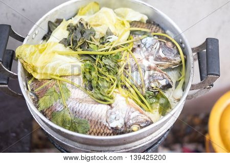 steamed Tilapia with vegetable Thai food in pot