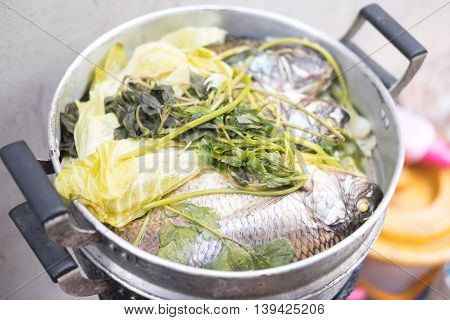 Steamed Tilapia with vegetable in pot Thai food