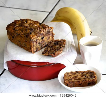 Fresh sliced banana bread and black coffee.