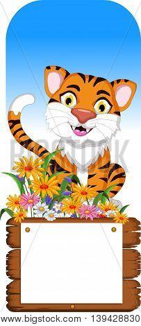 cute baby tiger cartoon with blank board