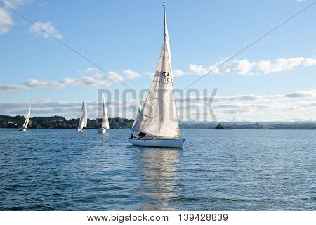 Kerikeri, New Zealand (NZ) - June 19 2016: A typical winter's day in Northland, yacht racing with Kerikeri Cruising Club in the Bay of Islands.