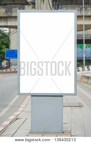 Blank Billboard On Road With City View Background