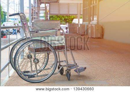 Empty wheelchair parked in Patient Rooms at hospital.