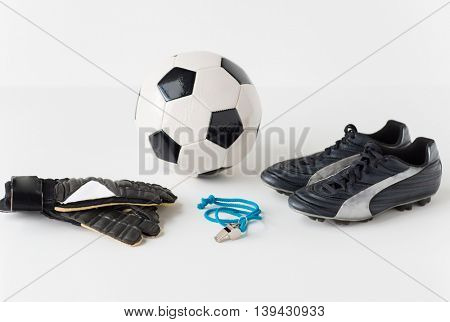 sport, soccer and sports equipment concept - close up of ball, whistle, goalkeeper gloves and football boots