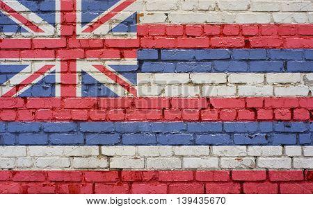 Hawaii US flag painted on old vintage brick wall