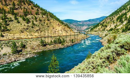 Thompson River with its many rapids flowing through the Canyon in the Coastal Mountain Ranges of British Columbia, Canada