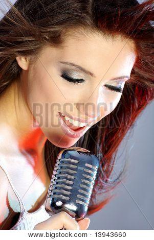 Rock star.Sexy Girl singing in retro mic