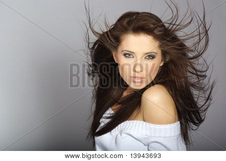 Portrait of a beautiful sexy woman over gray background